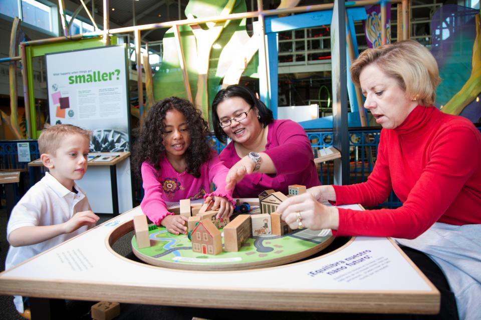 "Visitors manipulate the ""Balance Our Nano Future"" exhibit at Port Discovery Children's Museum in Baltimore, MD."