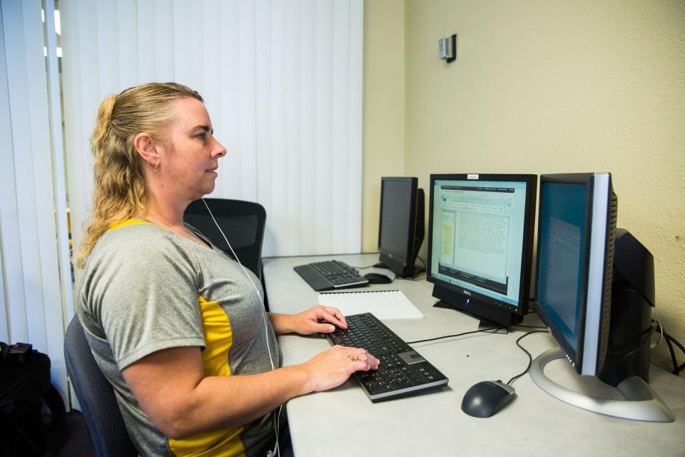 Melody Taylor, a linguistics major and proofreader in the lab