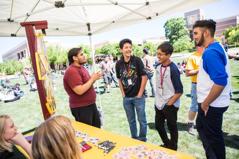 high school students at ASU tent