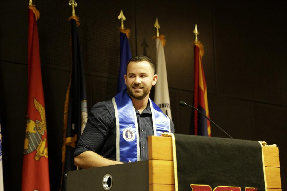 student speaking at ceremony