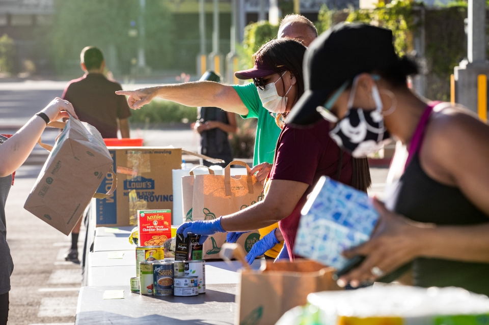 Volunteers sort donations at the First People's Resource Drive