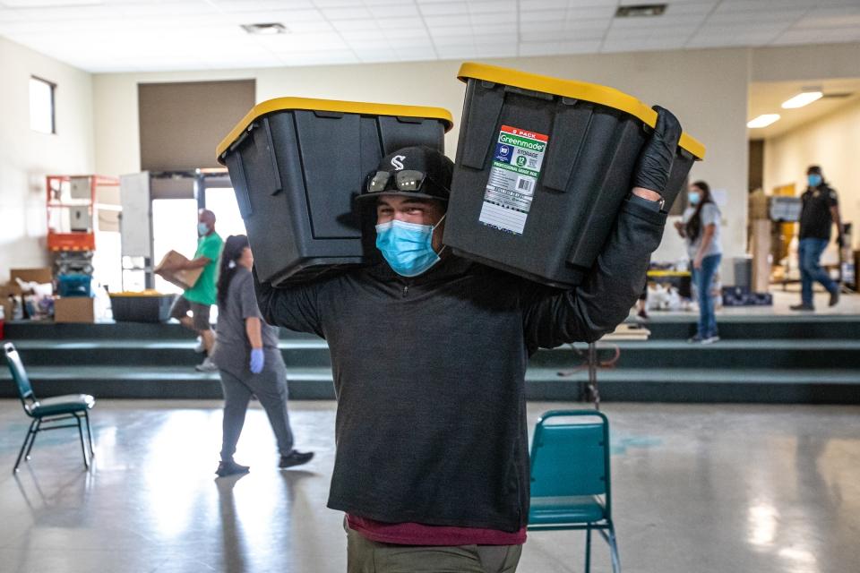 Volunteer carries donation bins