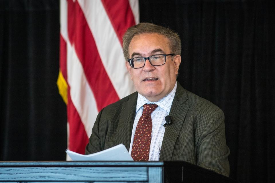 man speaking at lectern