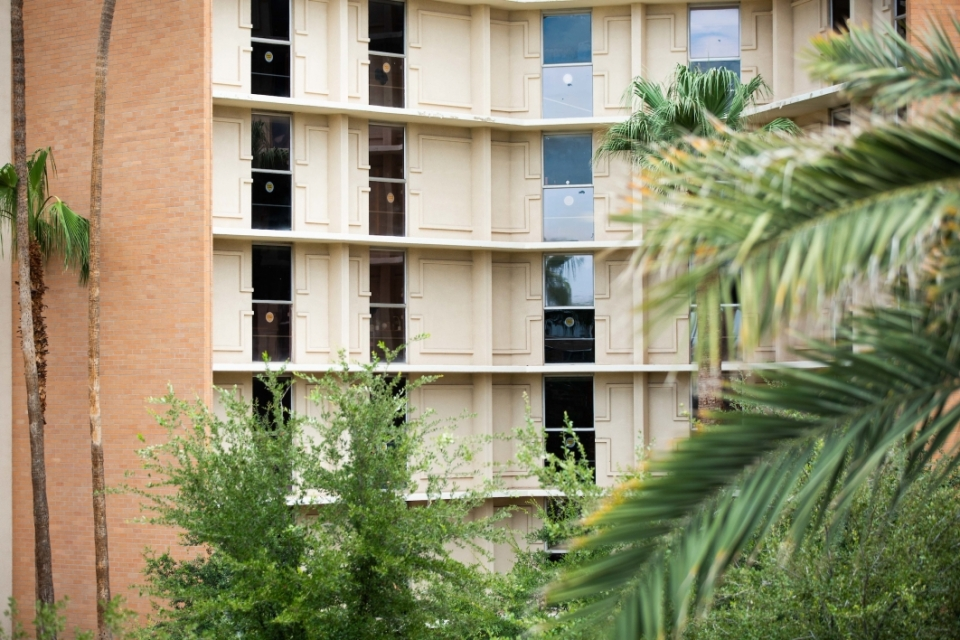 """exterior of ASU building in which students have affixed decals that read, """"Hearts of Gold"""" to their windows"""