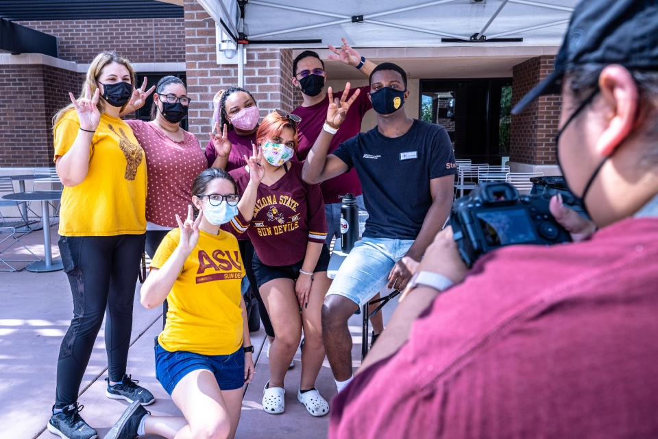 students posing for photo during move-in
