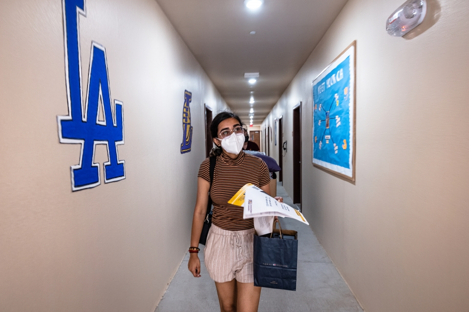 student walking down residential facility hall