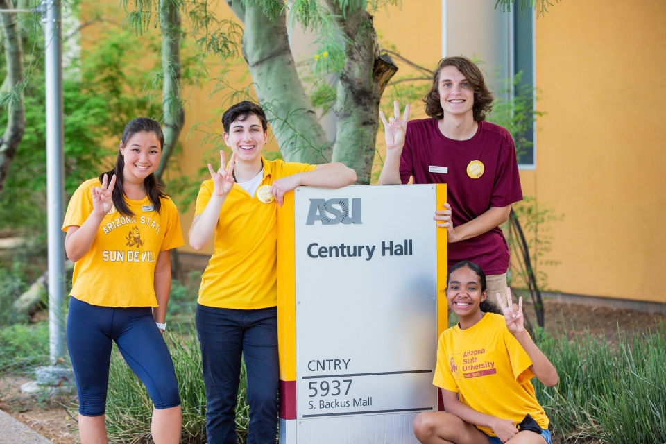 people posing for photo in front of Century Hall residential hall