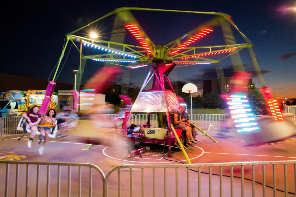 students ride on a carnival ride