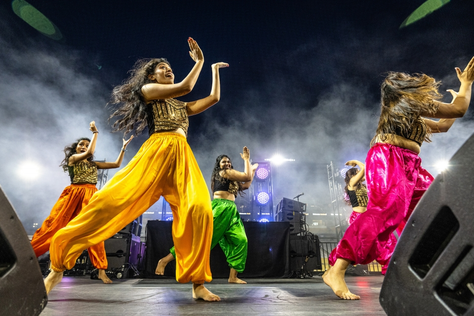 Bollywood dancer team performing on stage