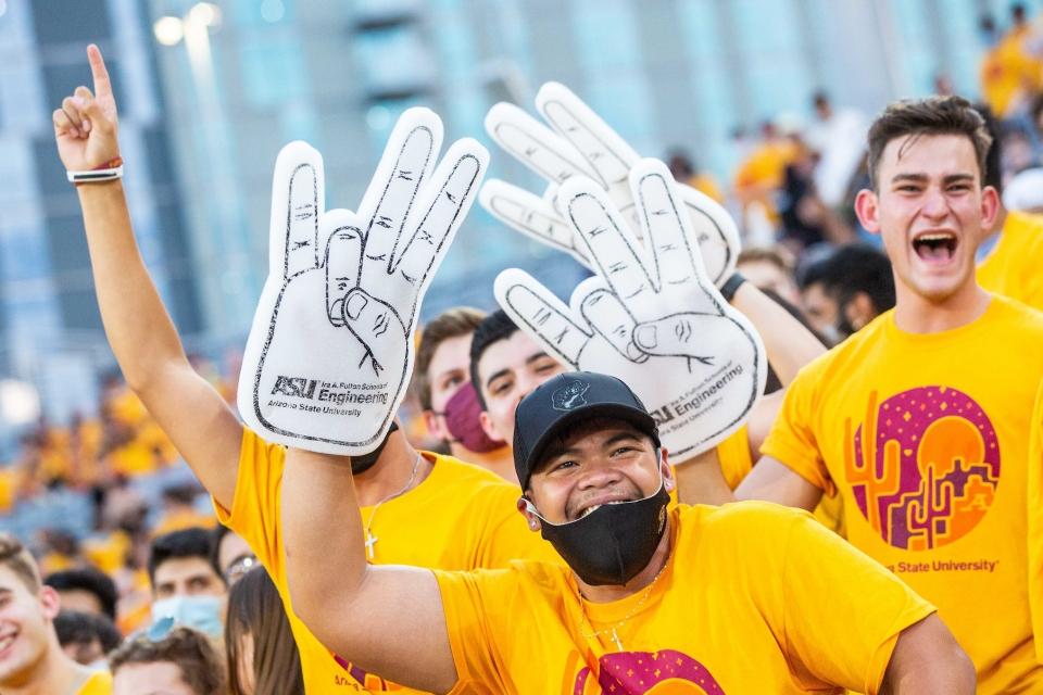 students waving foam fingers