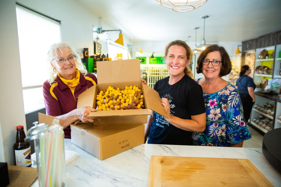 women holding box of dates