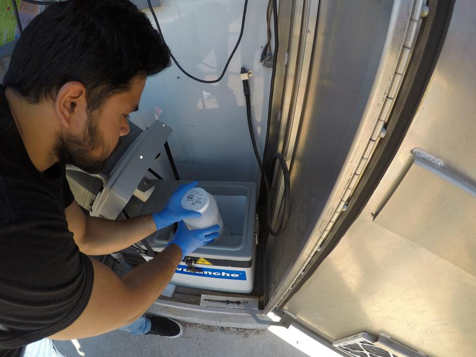 ASU PhD candidate Varun P. Kelkar examines a water sampling station