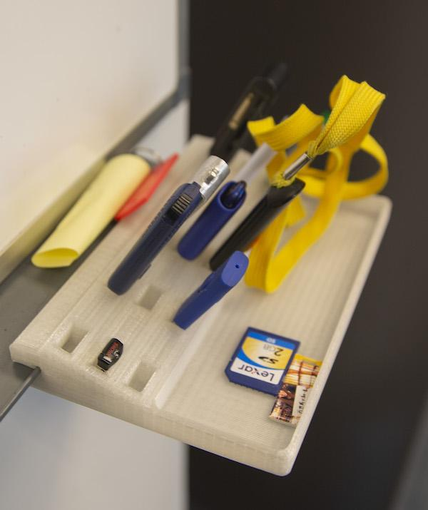 Items on a tray printed with recycled 3D printer plastic filament.