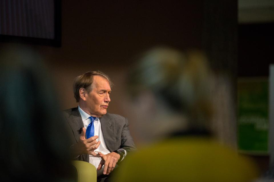 close up of charlie rose on stage speaking to audience