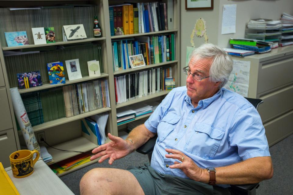 ASU professor Andrew Smith speaks in his office