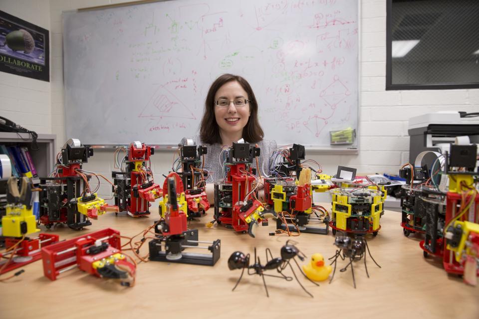 ASU engineer posing with bio-inspired robots
