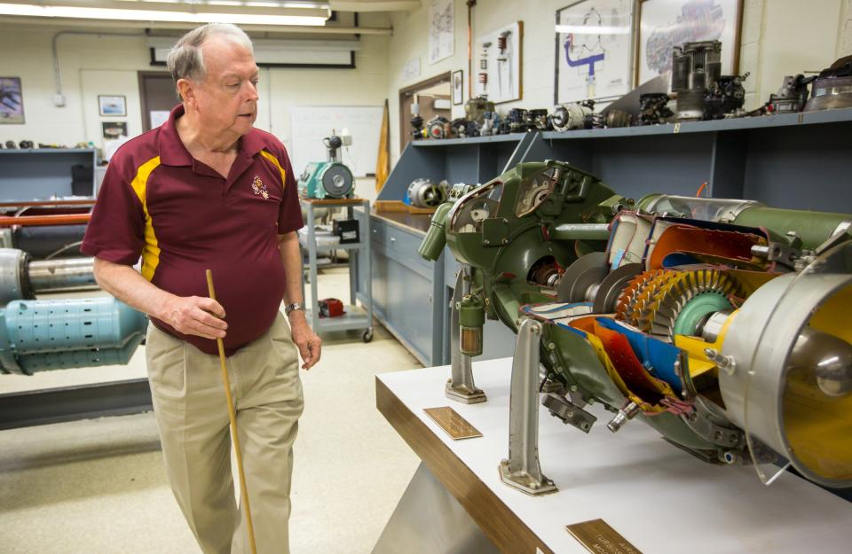 Aviation instructor Jimmy Kimberly walks in a lab.