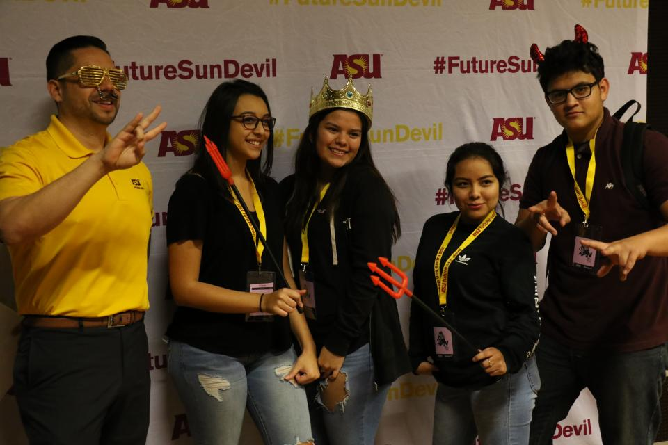 students posing at photo booth