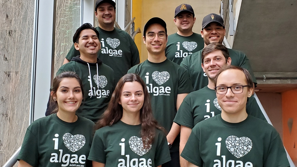 group of students wearing green I love algae shirts