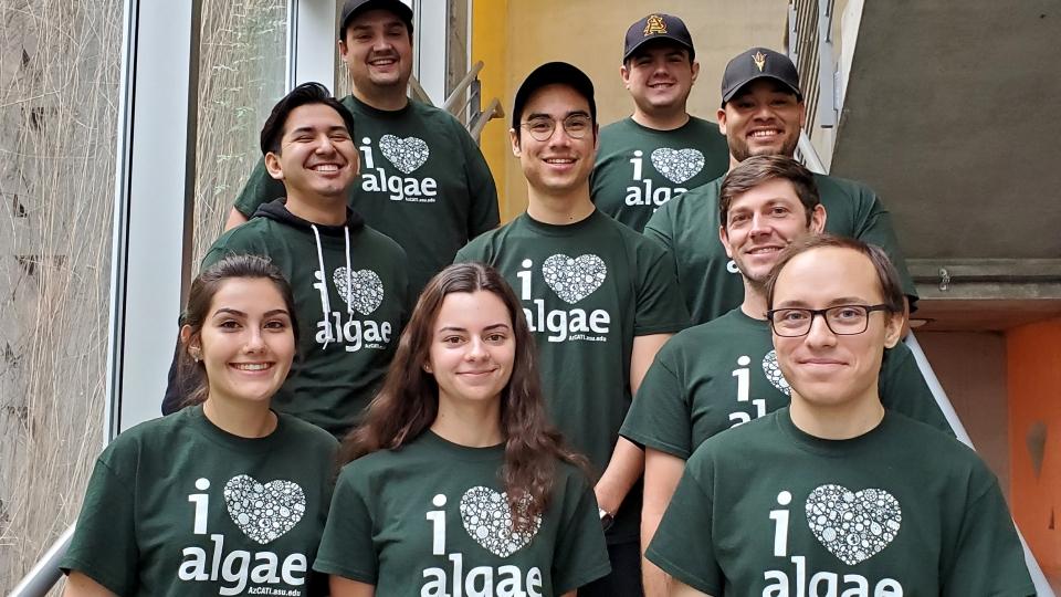 group of students wearing green I love algae shirts