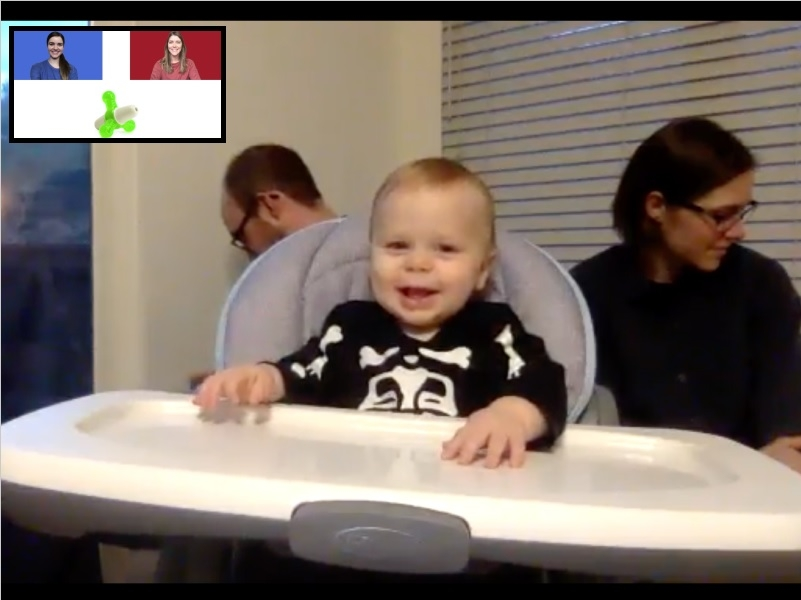 baby in a high chair smiling