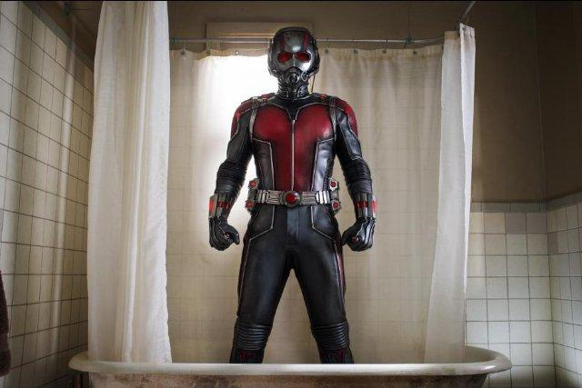 A man stands in a shower wearing the Ant-Man suit.
