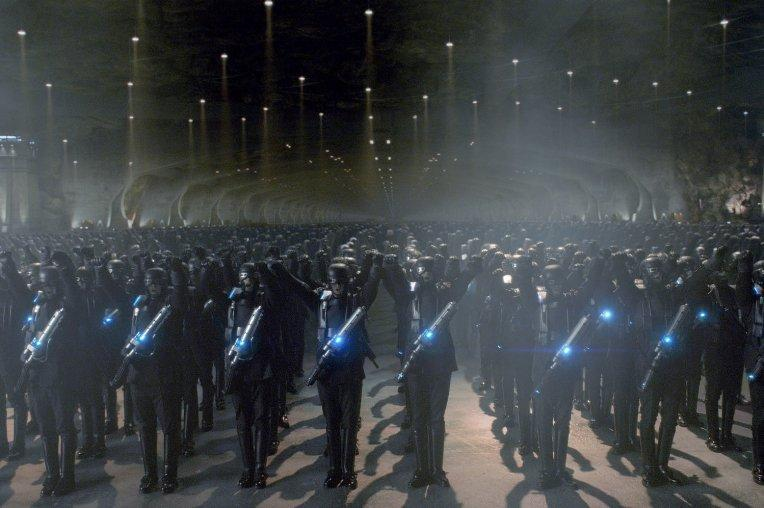 An army stands in a dark cave