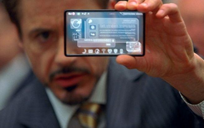 A man holds up a see-through phone.