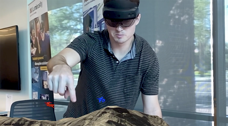 ASU graduate student Dylan Kerr demonstrates the Next-Gen Debrief 3D augmented reality system.