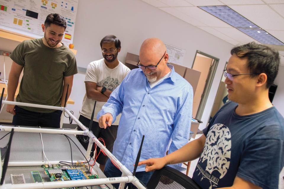 Daniel Bliss teaches students