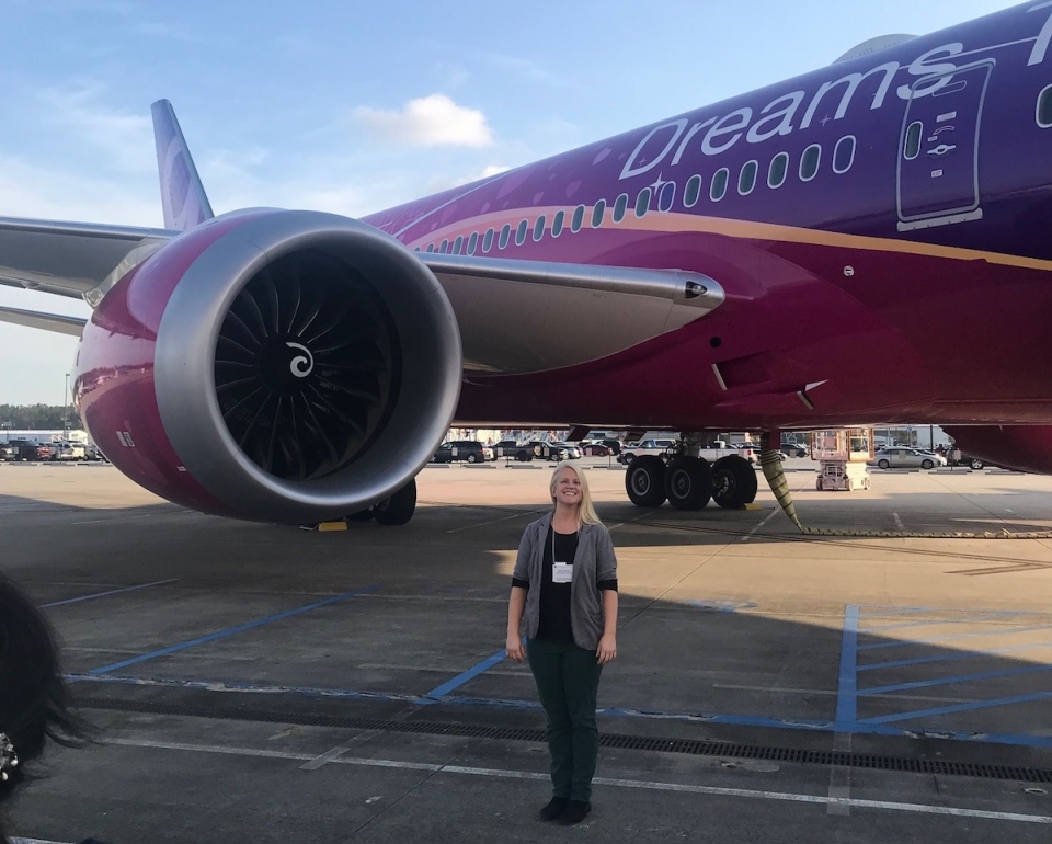 Rebecca Muenich in front of a Boeing 787 airplane