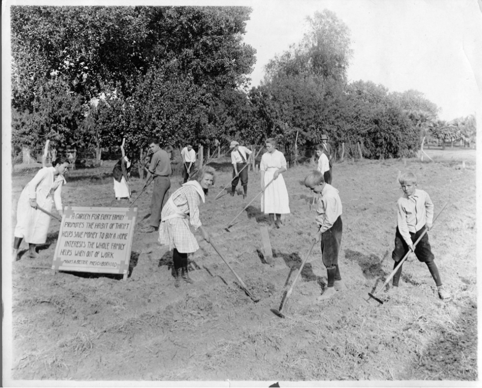 Archival photo of students gardening at ASU