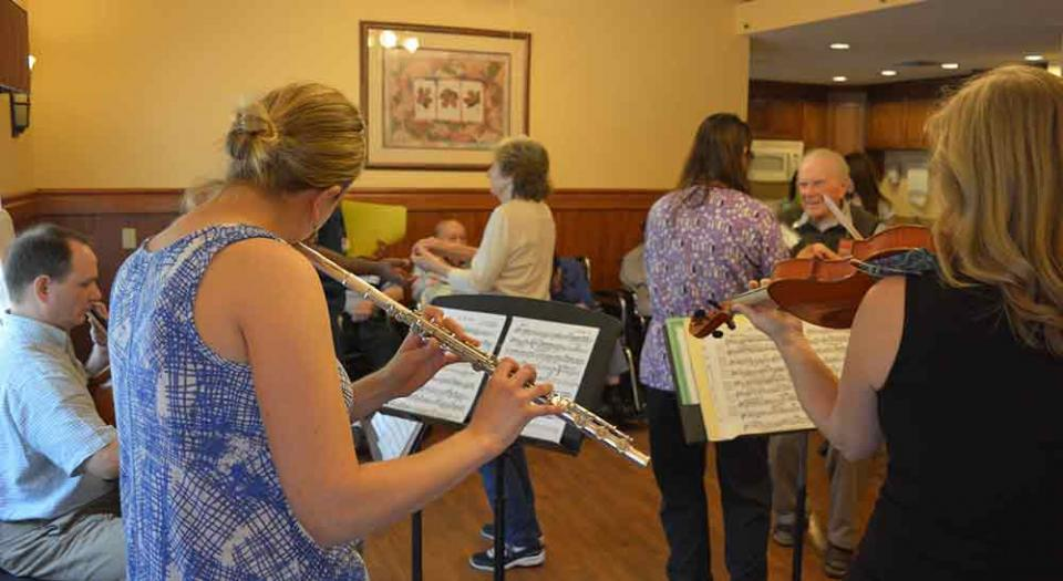 people playing music at assisted home