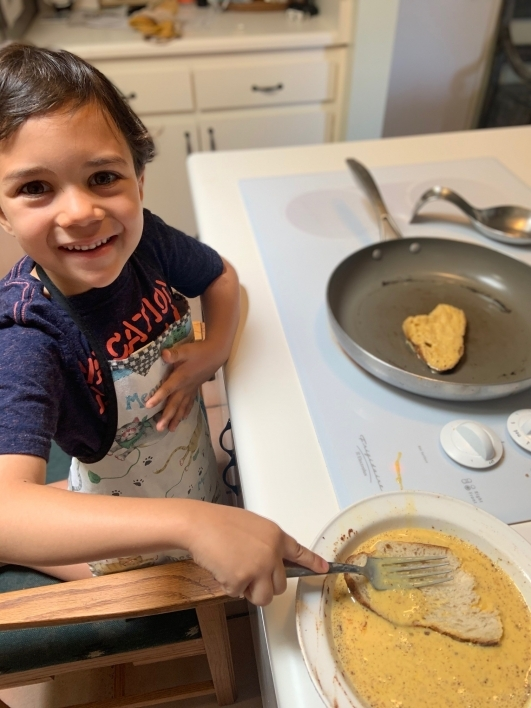 Five year old Henry cooking