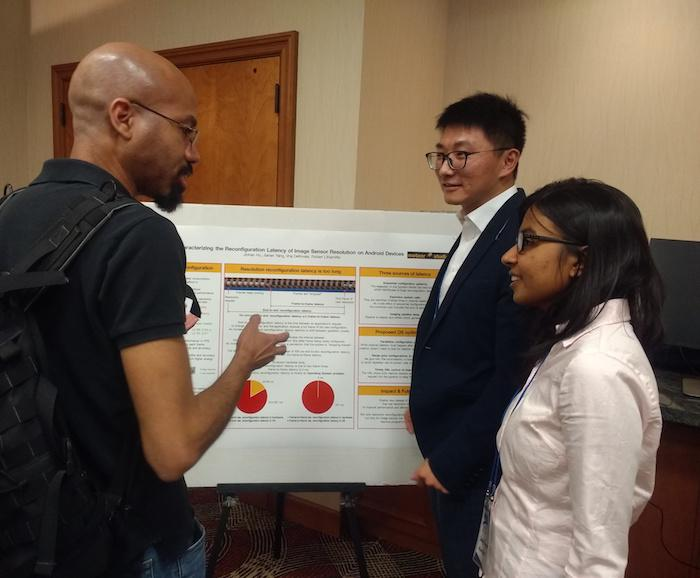 3 people talking about poster presentation