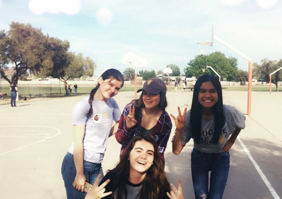 Group photo of ASU student mentors on the playground at a Tempe middle school