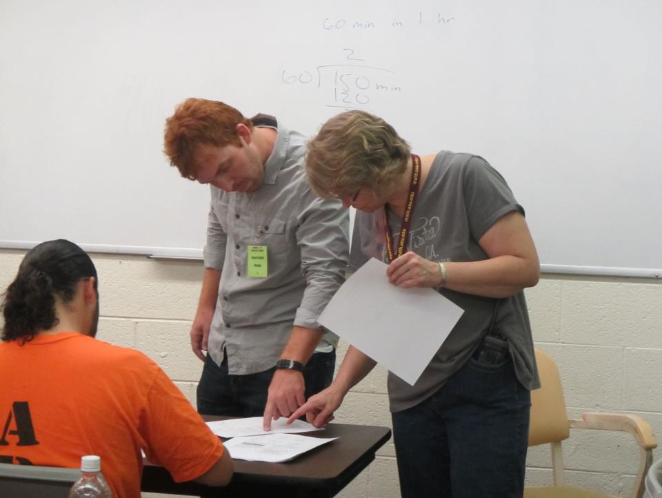 ASU teachers help an inmate with math homework