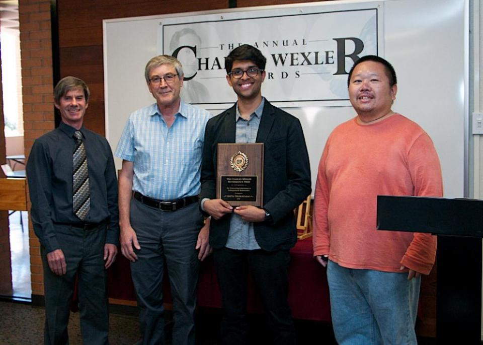 Aditya Dhumuntarao receiving the Charles Wexler Mathematics Prize