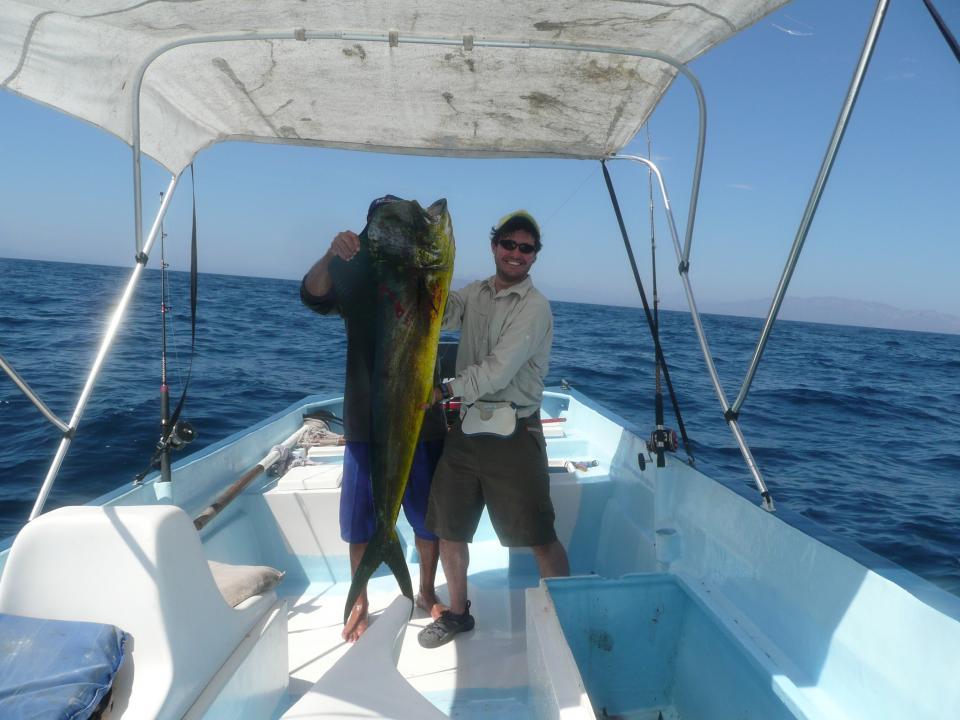 Fishermen hold a dorado