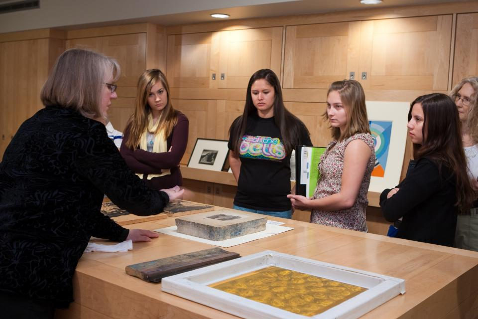 Curator of Prints Jean Makin interacts with students at the ASU Art Museum
