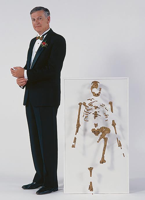 Donald Johanan stands with the skeleton Lucy that he discovered.