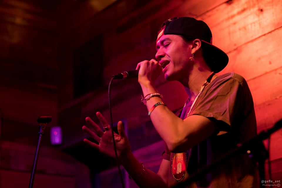 Young man singing and holding microphone