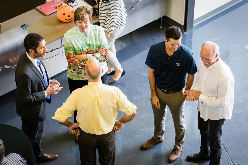 New ASU English chair Krista Ratcliffe talks with other ASU faculty and staff at the Ross-Blakley Hall open house on October 31, 2017 / Photo by Bruce Matsunaga