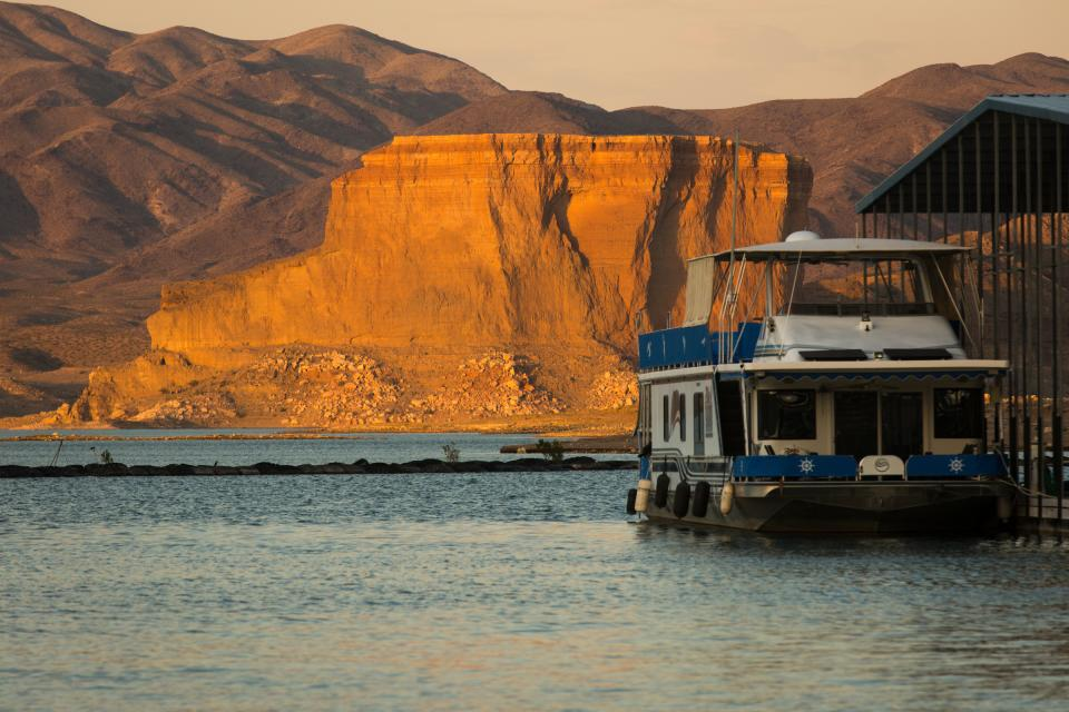 A large boat sits at a marina at Lake Mead