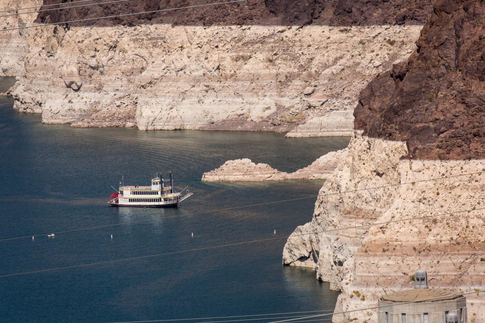 A tourist boat travels around Lake Mead.