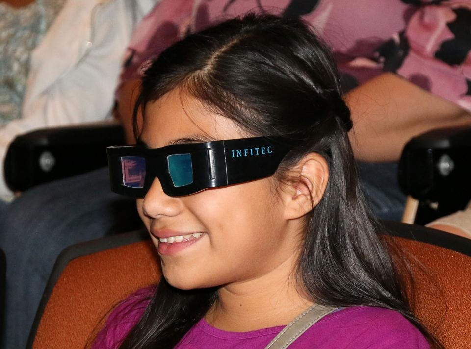 A girl prepares to watch a 3-D movie