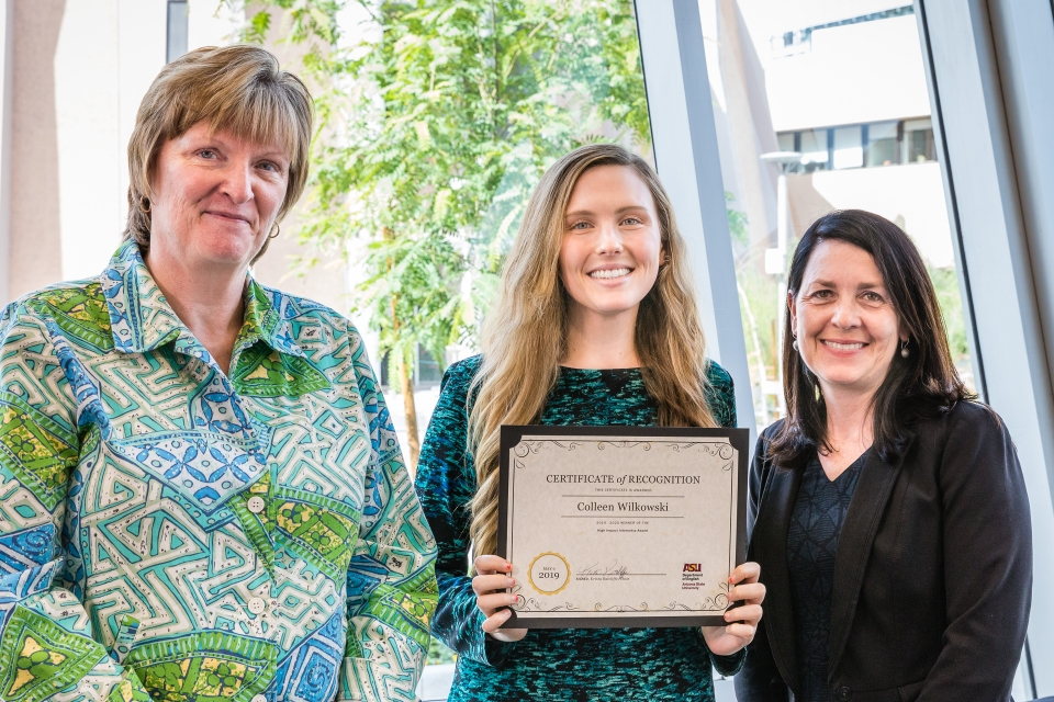 Collen Wilkowski was one of two recipients (with Easley) of the inaugural High Impact Internship Award from the Department of English in 2019. Here, she receives her award from English Chair Kris Ratcliffe (left) and Associate Chair Doris Warriner (right)