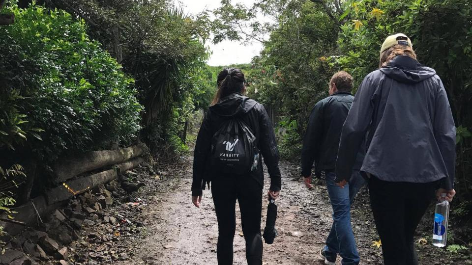Students traversed muddy trails with the Mayo Clinic Global Medical Brigade
