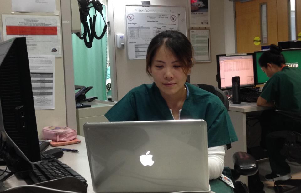 A photograph of Mi Young Lee, at the hopsital in which she works, in Seoul, Korea.