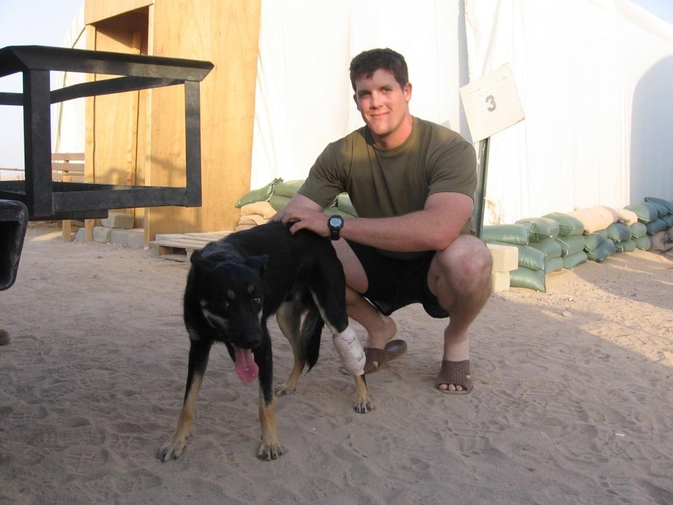 Man petting a dog